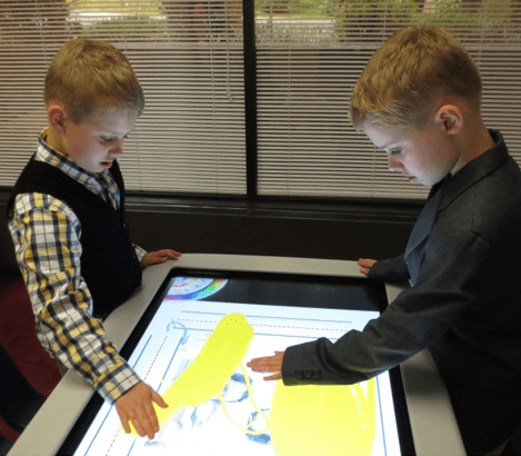 Children playing with touch screen